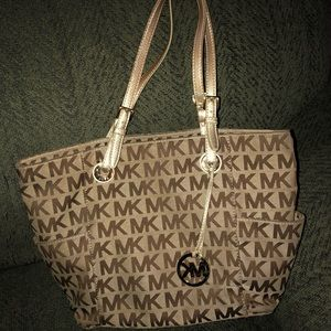 Michael Kors gold and tan purse